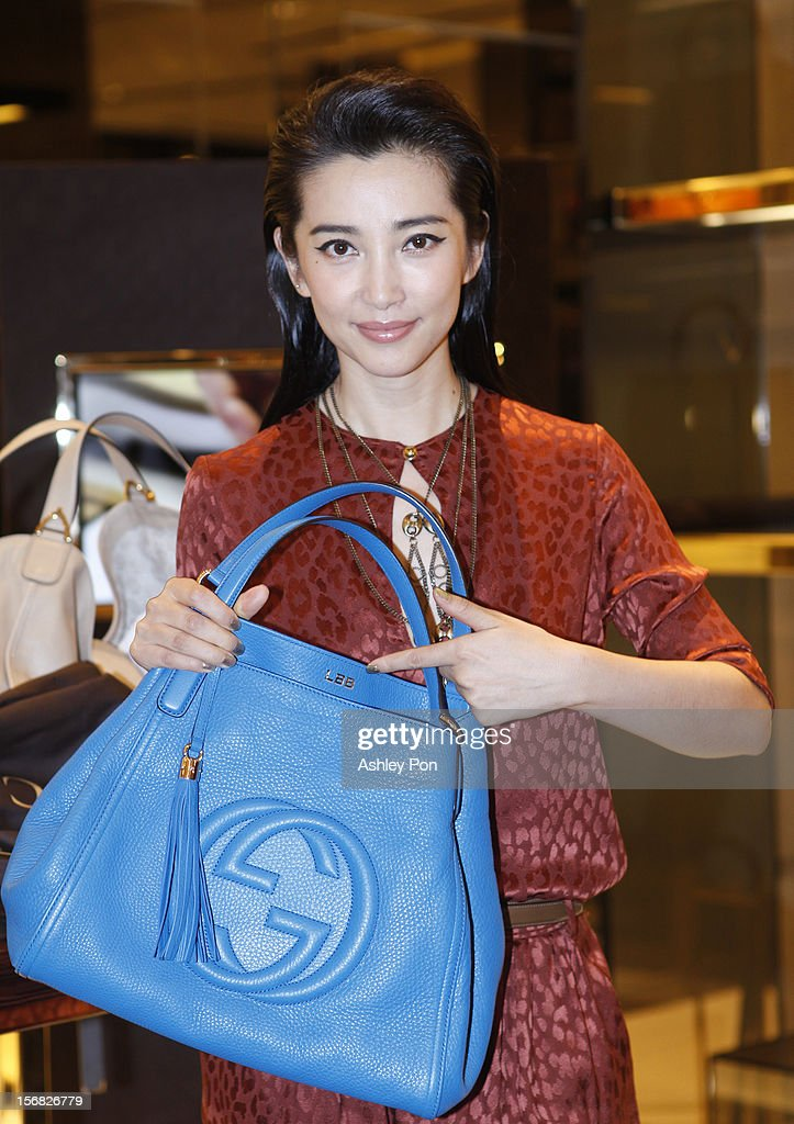 Li Bingbing photographed with a Gucci bag at the Gucci Flagship store opening at Taipei101 on November 22, 2012 in Taipei, Taiwan.