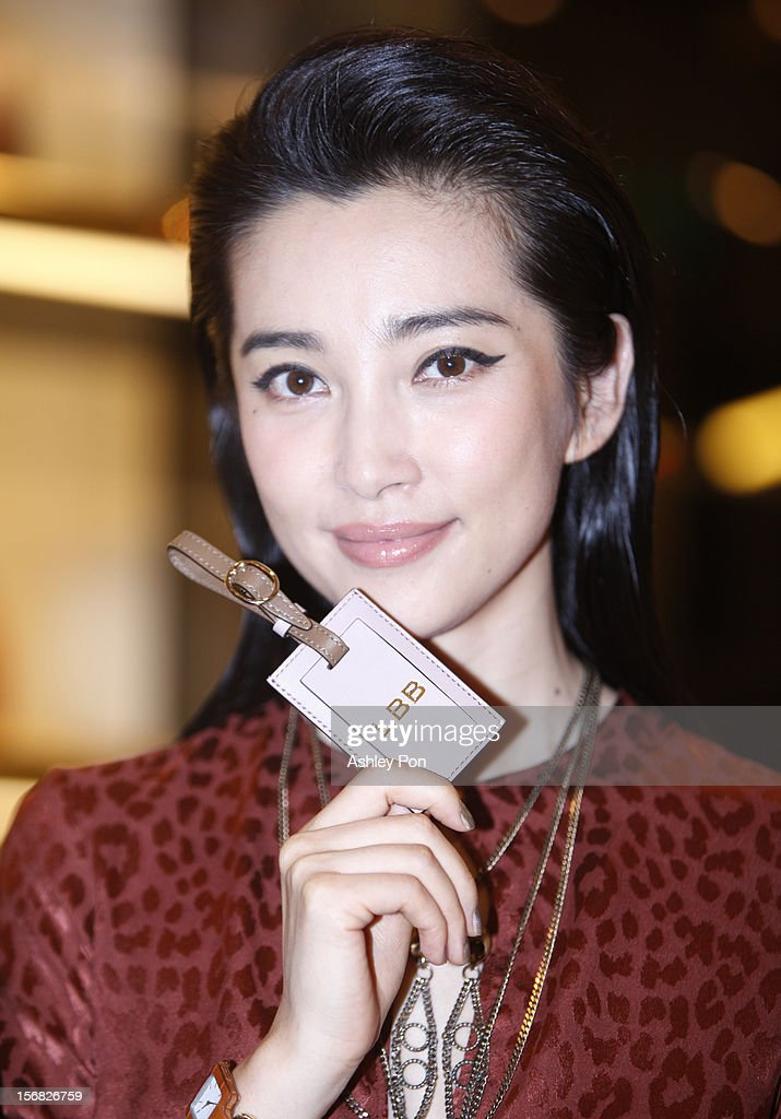 Li Bingbing poses for a photograph with her Gucci name tag at the Gucci Flagship store opening at Taipei101 on November 22, 2012 in Taipei, Taiwan.