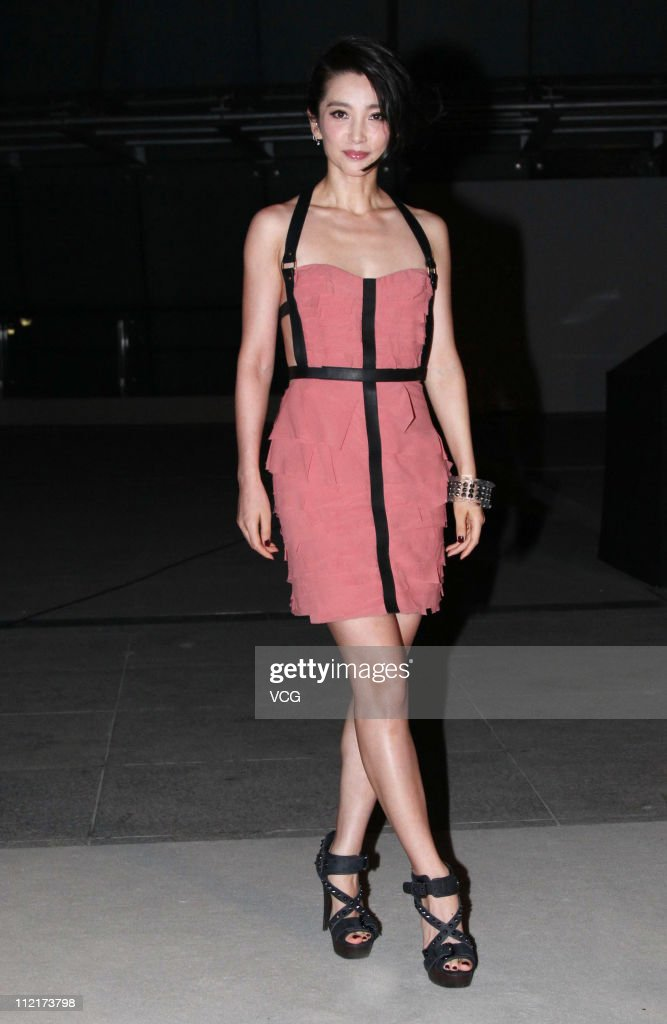 <a gi-track='captionPersonalityLinkClicked' href=/galleries/search?phrase=Li+Bingbing&family=editorial&specificpeople=697017 ng-click='$event.stopPropagation()'>Li Bingbing</a> poses for photos as she arrives at the corporate event of the fashion apparel company Burberry at Sparkle Roll Plaza on April 13, 2011 in Beijing, China.