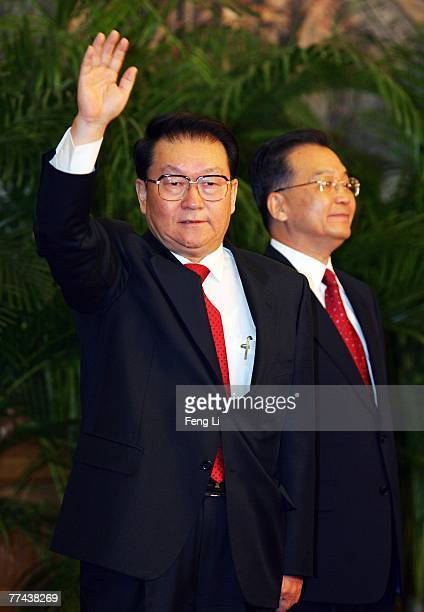 Li Changchun one of the members of new nineseat Politburo Standing Committee greets the media at the Great Hall of the People on October 22 2007 in...