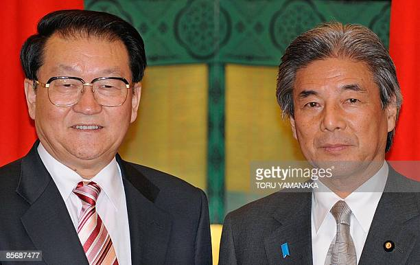 Li Changchun standing committee member of Chinese Communist Party's Political Bureau is welcomed by Japanese Foreign Minister Hirofumi Nakasone prior...