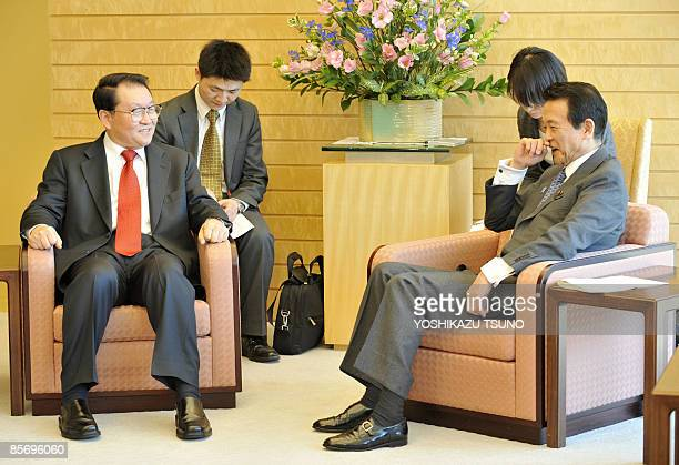 Li Changchun standing committee member of Chinese Communist Party's Political Bureau chats with Japanese Prime Minister Taro Aso at the latter's...