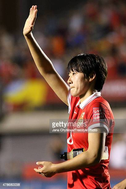 Li Dongna of China acknowledges the crowd after being defeated by the United States 10 in the FIFA Women's World Cup 2015 Quarter Final match at...