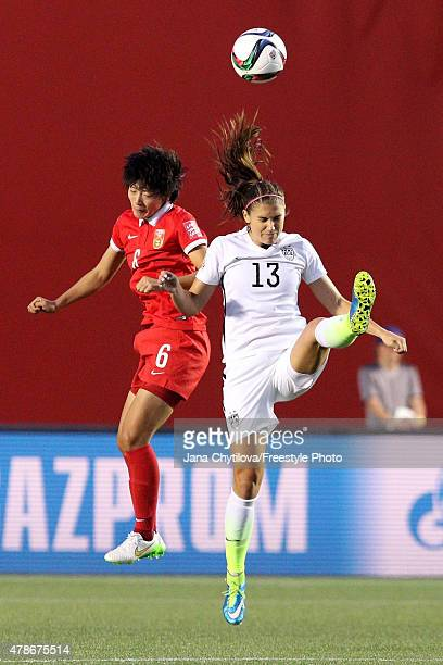 Li Dongna of China and Alex Morgan of the United States go up for a header in the second half in the FIFA Women's World Cup 2015 Quarter Final match...