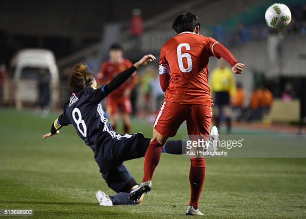 Li Dongna of China and Aya Miyama of Japan compete for the ball during the AFC Women's Olympic Final Qualification Round match between Japan and...