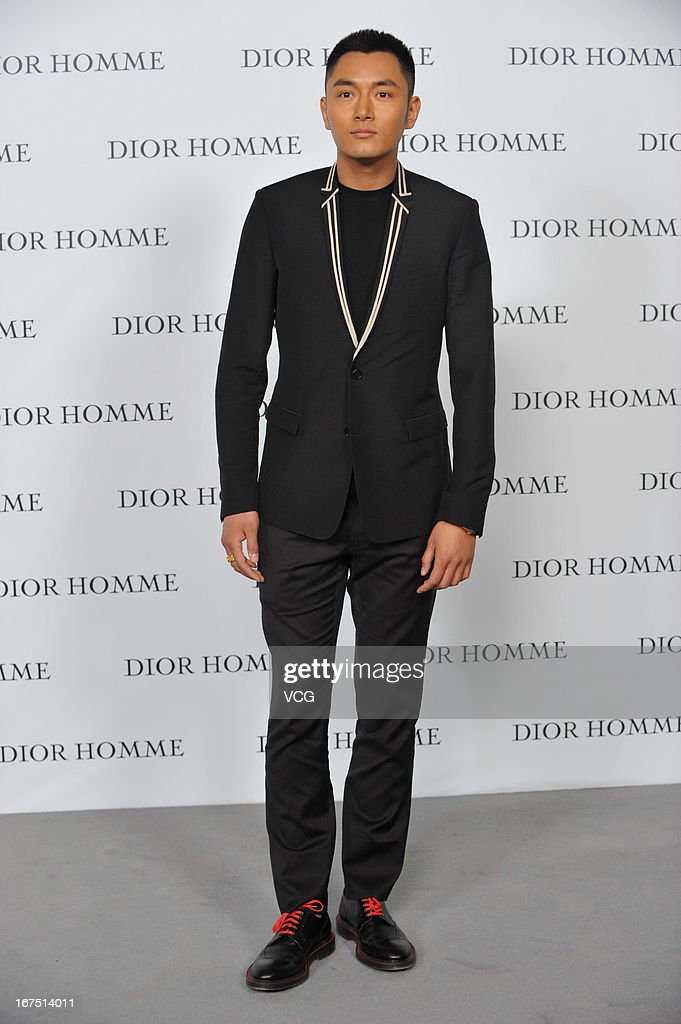 Li Dongxue attends the Dior Homme F/W 2013 Menswear Collection Show on April 25, 2013 in Beijing, China.