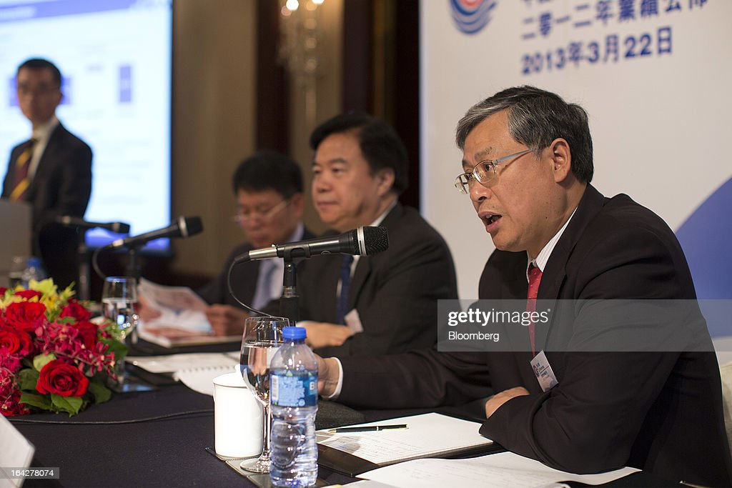 Li Fanrong, chief executive officer of Cnooc Ltd., right, speaks as Wang Yilin, chairman of Cnooc Ltd., center, listens during a news conference in Hong Kong, China, on Friday, March 22, 2013. Cnooc reported 2012 profit that missed analyst estimates as China's biggest offshore oil producer spent more to explore and revive stalled output growth. Photographer: Jerome Favre/Bloomberg via Getty Images