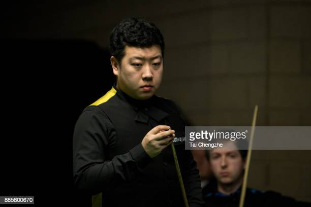 Li Hang of China chalks the cue during his third round match against Scott Donaldson of Scotland on day 8 of 2017 Betway UK Championship at Barbican...