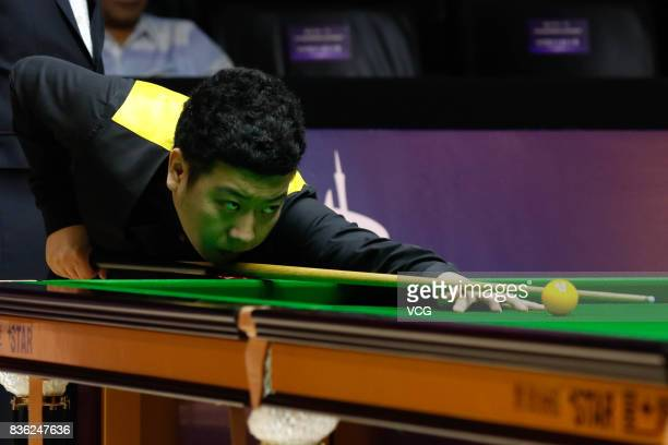 Li Hang of China plays a shot during his semifinal match against Luca Brecel of Belgium on day six of Evergrande 2017 World Snooker China Champion at...