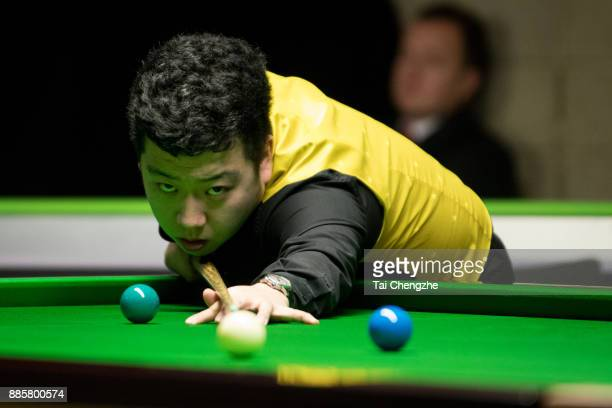 Li Hang of China plays a shot during his third round match against Scott Donaldson of Scotland on day 8 of 2017 Betway UK Championship at Barbican...