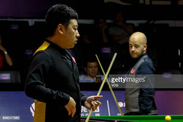 Li Hang of China reacts during his semifinal match against Luca Brecel of Belgium on day six of Evergrande 2017 World Snooker China Champion at...