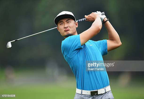 Li Hao Tong of China plays a shot during the third round of the Shenzhen International at Genzon Golf Club on April 18 2015 in Shenzhen China