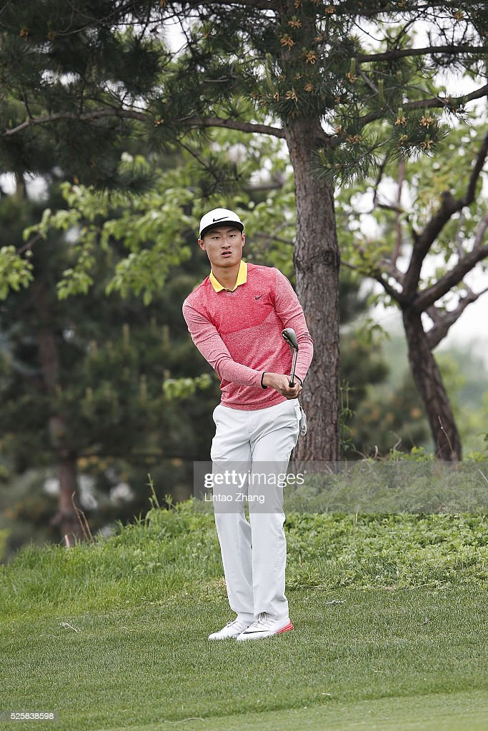 Li Haogtong of China plays a shot during the second round of the Volvo China open at Topwin Golf and Country Club on April 28, 2016 in Beijing, China.