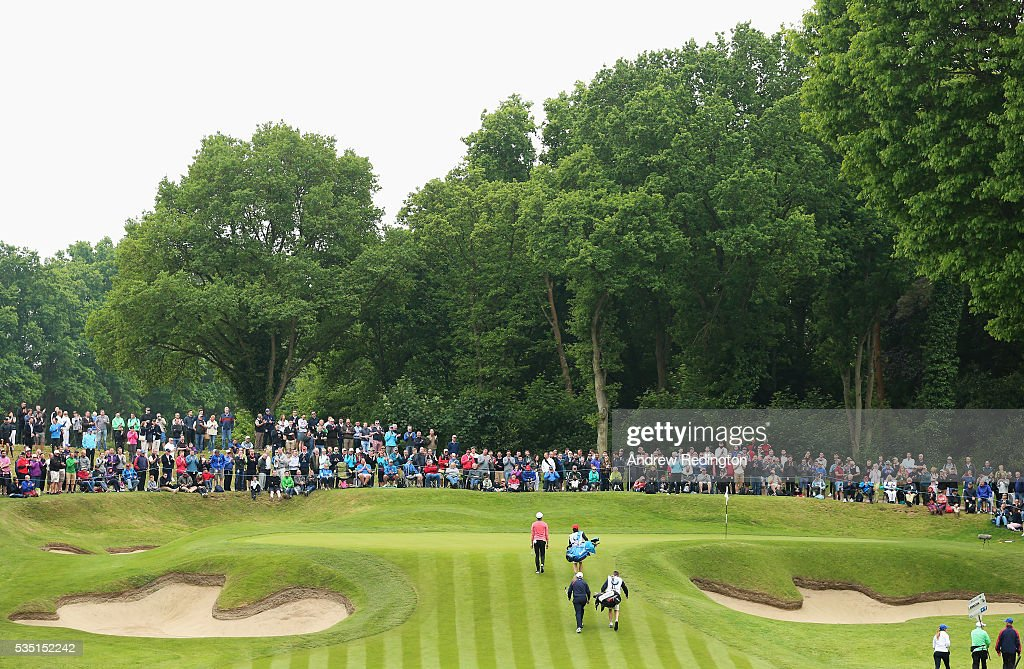 Li Haotong of China and <a gi-track='captionPersonalityLinkClicked' href=/galleries/search?phrase=Andrew+Johnston+-+Golfer&family=editorial&specificpeople=15823456 ng-click='$event.stopPropagation()'>Andrew Johnston</a> of England approach the 2nd green during day four of the BMW PGA Championship at Wentworth on May 29, 2016 in Virginia Water, England.