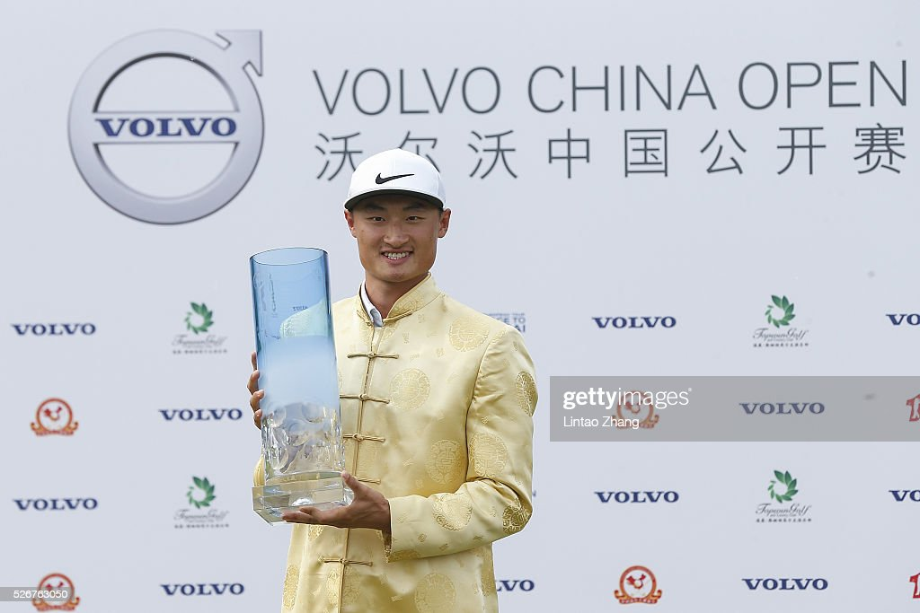 Li Haotong of China holds the trophy after winning the Volvo China Open at Topwin Golf and Country Club on May 1, 2016 in Beijing, China.