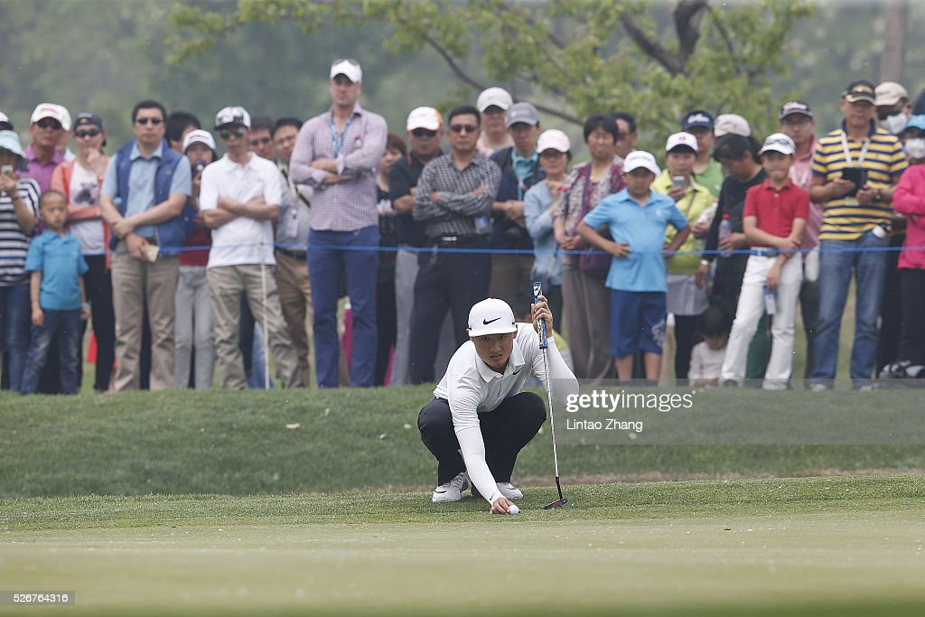 Li Haotong of China plays a shot during the final round of the Volvo China open at Topwin Golf and Country Club on May 1, 2016 in Beijing, China.