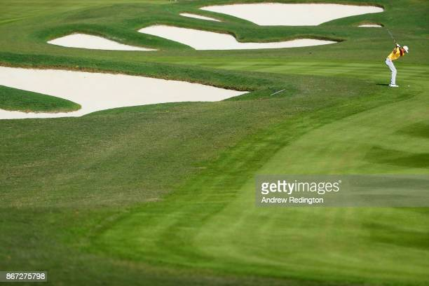Li Haotong of China plays a shot on the tenth hole during the third round of the WGC HSBC Champions at Sheshan International Golf Club on October 28...