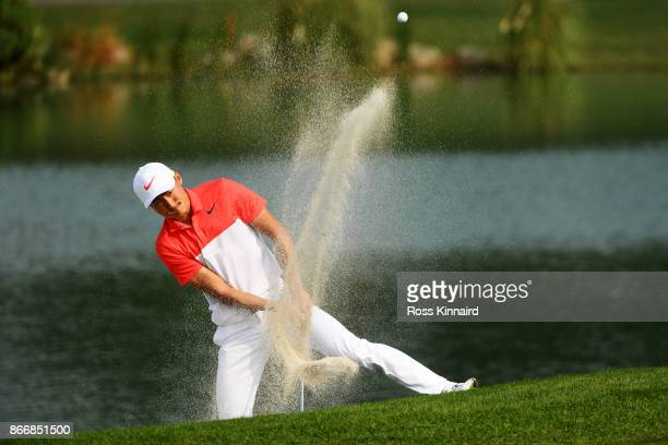 Li Haotong of China plays his fourth shot from a bunker on the fourth hole during the second round of the WGC HSBC Champions at Sheshan International...