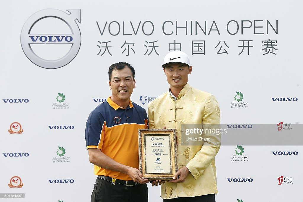 Li Haotong (R) with Zhang Lianwei pose for a photo after winning the Volvo China Open at Topwin Golf and Country Club on May 1, 2016 in Beijing, China.
