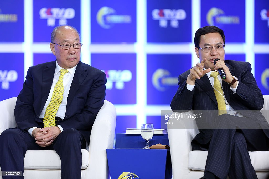 <a gi-track='captionPersonalityLinkClicked' href=/galleries/search?phrase=Li+Hejun&family=editorial&specificpeople=11952696 ng-click='$event.stopPropagation()'>Li Hejun</a> (R), Chairman of Hanergy Holding Group, and Wan Long, Chairman of Shuanghui Group, attend the 2013 China Central Television (CCTV) Financial Forum at China World Trade Center Tower III on December 11, 2013 in Beijing, China. The three-day forum opened on Tuesday ahead of the '2013 CCTV China Economic Person Of The Year Award'.