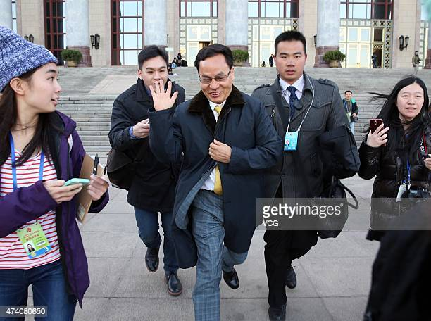 Li Hejun Chairman of Hanergy Holding Group walks out of the Great Hall of the People after a meeting of the Chinese People's Political Consultative...