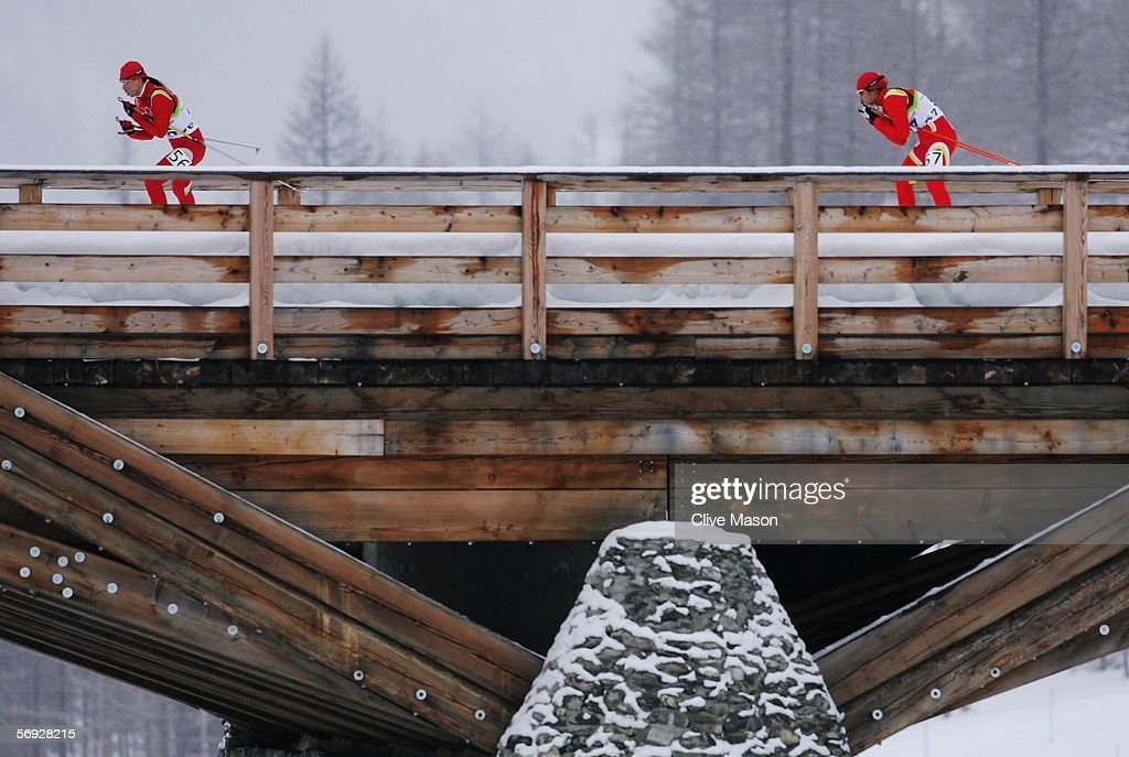 Li Huo and Dandan Man of China competes in the Womens Cross Country Skiing 30km Mass Start Final on Day 14 of the 2006 Turin Winter Olympic Games on...