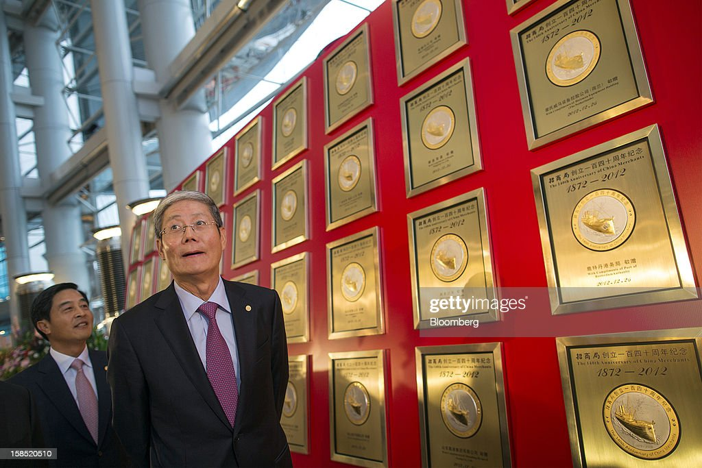 Li Jianhong, president of China Merchants Group Ltd., left, and Fu Yuning, chairman of China Merchants Group Ltd., right, reviews a selection of commemorative plaques celebrating the company's 140th anniversary prior to a news conference in Hong Kong, China, on Tuesday, Dec. 18, 2012. China Merchants Group, an investment holding company, comprises of property management, transportation and financial investment businesses. Photographer: Jerome Favre/Bloomberg via Getty Images