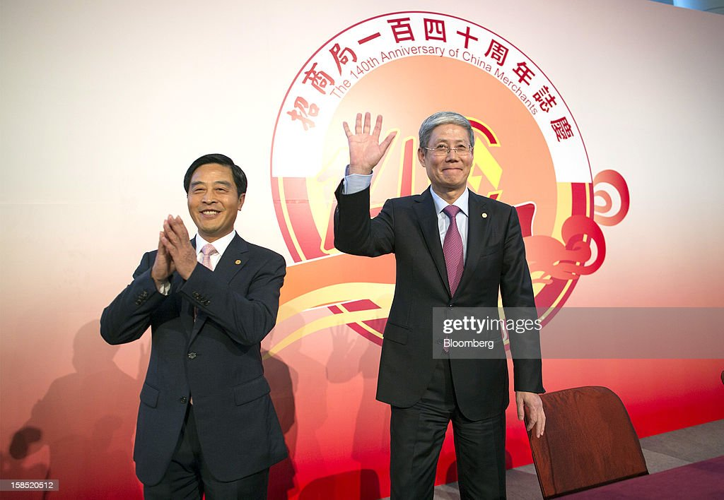 Li Jianhong, president of China Merchants Group Ltd., left, and Fu Yuning, chairman of China Merchants Group Ltd., gesture before the start of a news conference in Hong Kong, China, on Tuesday, Dec. 18, 2012. China Merchants Group, an investment holding company, comprises of property management, transportation and financial investment businesses. Photographer: Jerome Favre/Bloomberg via Getty Images