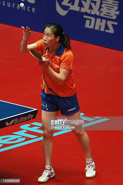 Li Jiao of Netherlands serves during her match against Liu Jia of Austria during the LIEBHERR table tennis team world cup 2012 championship division...