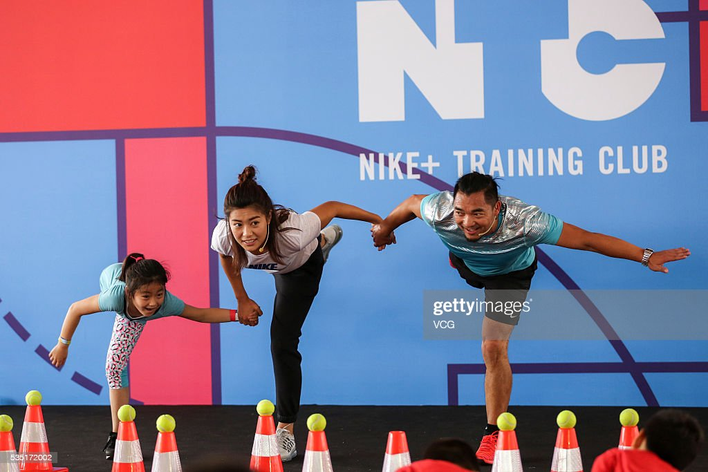 <a gi-track='captionPersonalityLinkClicked' href=/galleries/search?phrase=Li+Jiayue&family=editorial&specificpeople=9440786 ng-click='$event.stopPropagation()'>Li Jiayue</a> (C), a Chinese football defender who plays on the China women's national football team, attends a children's Day activity of Nike on May 29, 2016 in Shanghai, China.