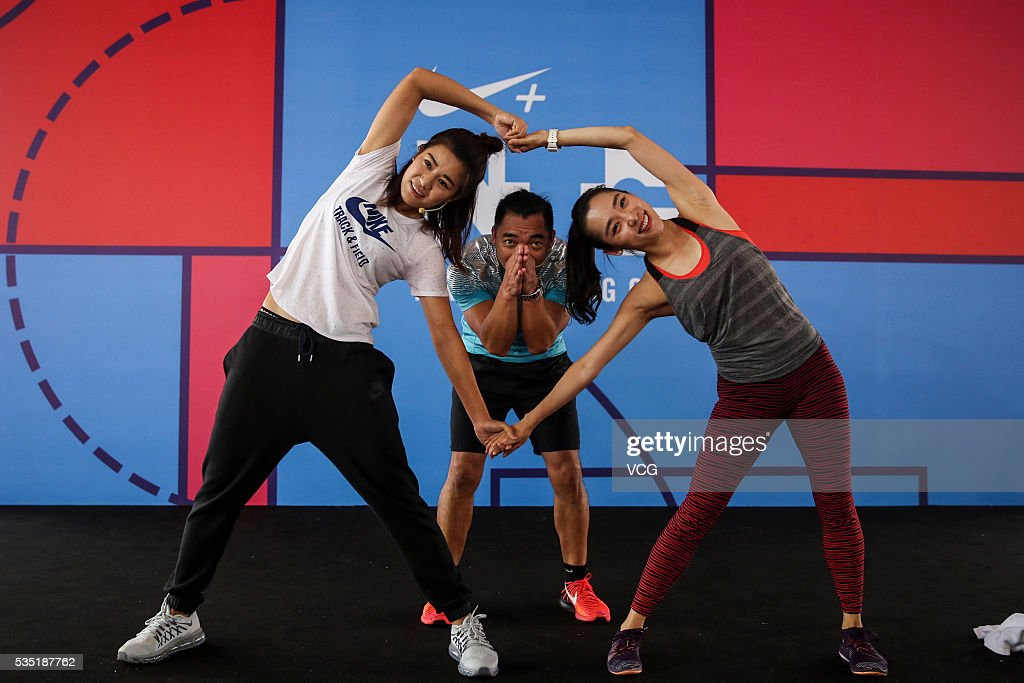 <a gi-track='captionPersonalityLinkClicked' href=/galleries/search?phrase=Li+Jiayue&family=editorial&specificpeople=9440786 ng-click='$event.stopPropagation()'>Li Jiayue</a> (L), a Chinese football defender who plays on the China women's national football team, attends a children's Day activity of Nike on May 29, 2016 in Shanghai, China.