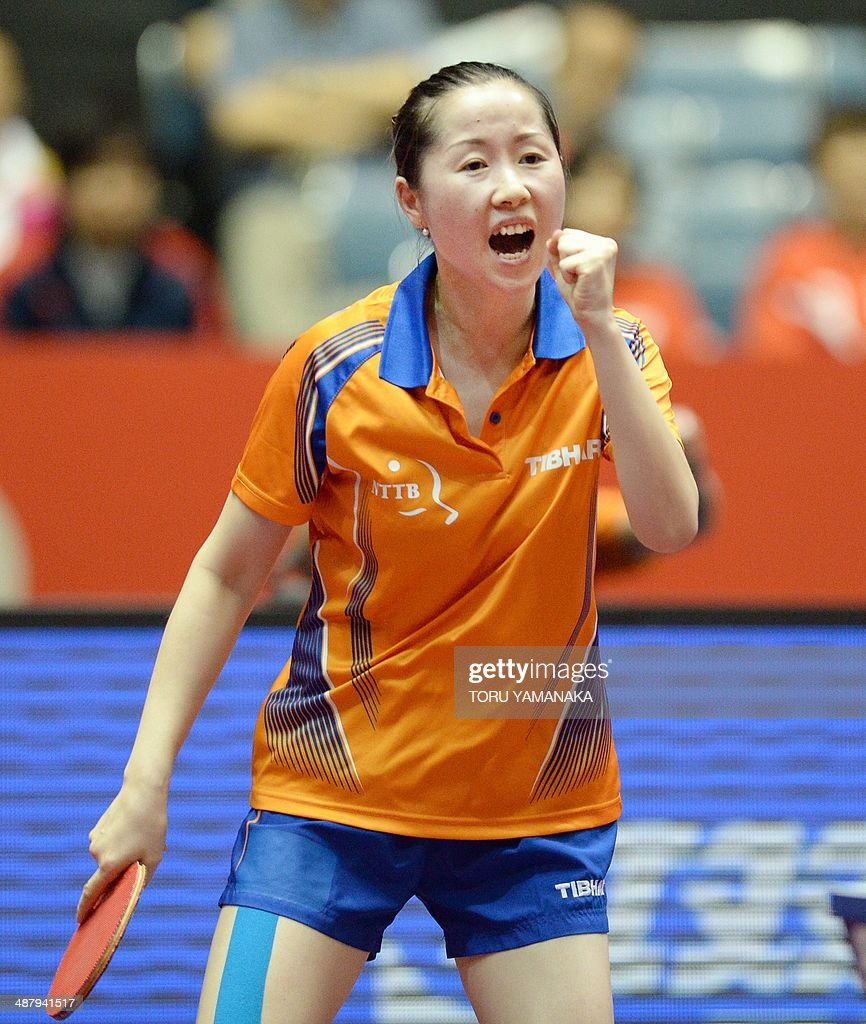 <a gi-track='captionPersonalityLinkClicked' href=/galleries/search?phrase=Li+Jie+-+Table+Tennis+Player&family=editorial&specificpeople=12783702 ng-click='$event.stopPropagation()'>Li Jie</a> of the Netherlands reacts after winning a point against Yuka Ishigaki of Japan during their women's team quarter-final match of the 2014 World Team Table Tennis Championships in Tokyo on May 3, 2014. AFP PHOTO/Toru YAMANAKA