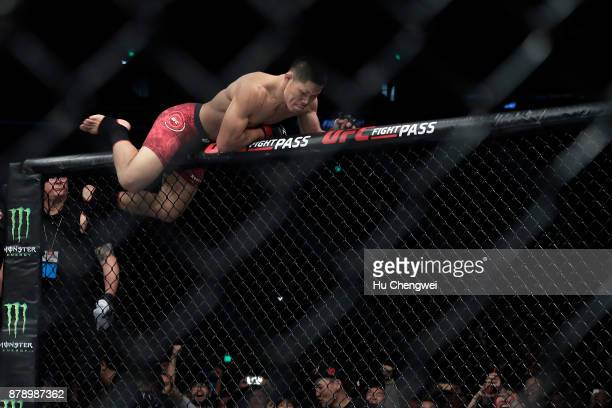 Li Jingliang climbs after his fight with Zak Ottow during the UFC Fight Night at MercedesBenz Arena on November 25 2017 in Shanghai China