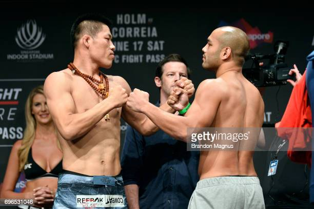 Li Jingliang of China and Frank Camacho of the Northern Mariana Islands face off during the UFC Fight Night weighin at the Marina Bay Sands on June...