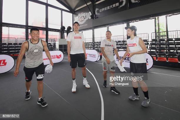 Li Jingliang Wu Guanxi Max Holloway Yu Fei at a UFC Basketball CrossOver event on August 3 2017 in Shanghai China