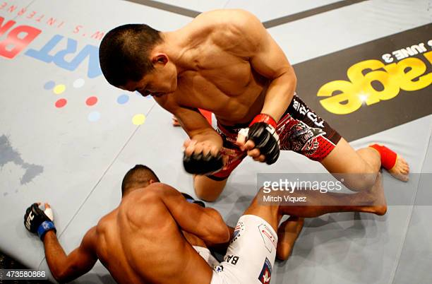 Li Jingling of China punches Dhiego Lima of Brazil in their welterweight fight during the UFC Fight Night event at the Mall of Asia Arena on May 16...