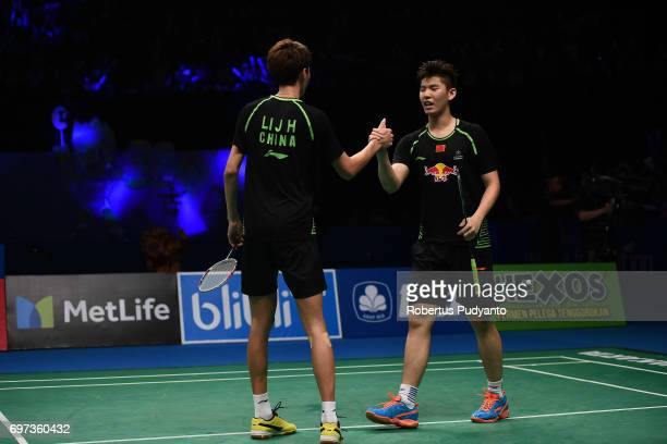 Li Junhui and Liu Yuchen of China celebrate victory after beating Mathias Boe and Carsten Mogensen of Denmark during Men's Double Final match of the...