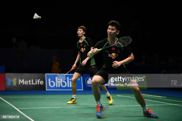 Li Junhui and Liu Yuchen of China compete against Mathias Boe and Carsten Mogensen of Denmark during Men's Double Final match of the BCA Indonesia...