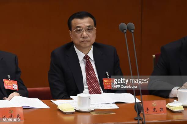 Li Keqiang a member of the Politburo Standing Committee of the Communist Party of China and China's Premier attends the opening session of the...