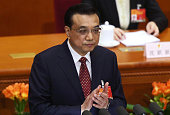 Li Keqiang China's premier applauds during a speech at the opening of the third session of the 12th National People's Congress at the Great Hall of...