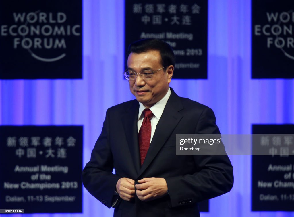 Li Keqiang, China's premier, arrives for the opening plenary at the World Economic Forum Annual Meeting of The New Champions in Dalian, China, on Wednesday, Sept. 11, 2013. Li said the foundations of a growth rebound aren't solid while cautioning that stimulus won't help resolve deep-rooted issues in the world's second-largest economy. Photographer: Tomohiro Ohsumi/Bloomberg via Getty Images