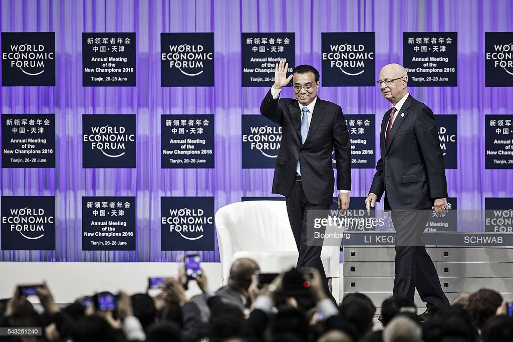 <a gi-track='captionPersonalityLinkClicked' href=/galleries/search?phrase=Li+Keqiang&family=editorial&specificpeople=2481781 ng-click='$event.stopPropagation()'>Li Keqiang</a>, China's premier, center, waves as he leaves the stage with <a gi-track='captionPersonalityLinkClicked' href=/galleries/search?phrase=Klaus+Schwab&family=editorial&specificpeople=569943 ng-click='$event.stopPropagation()'>Klaus Schwab</a>, chairman and founder of the World Economic Forum (WEF), after speaking at the opening plenary session of the WEF Annual Meeting of the New Champions in Tianjin, China, on Monday, June 27, 2016. Li said global uncertainties have increased after the U.K.'s vote to leave the European Union and said his nation has ample tools to meet challenges facing the economy. Photographer: Qilai Shen/Bloomberg via Getty Images