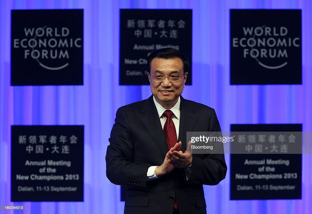 Li Keqiang, China's premier, claps as he arrives for the opening plenary at the World Economic Forum Annual Meeting of The New Champions in Dalian, China, on Wednesday, Sept. 11, 2013. Li said the foundations of a growth rebound aren't solid while cautioning that stimulus won't help resolve deep-rooted issues in the world's second-largest economy. Photographer: Tomohiro Ohsumi/Bloomberg via Getty Images