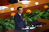 Li Keqiang China's premier delivers a speech during the opening of the third session of the 12th National People's Congress at the Great Hall of the...