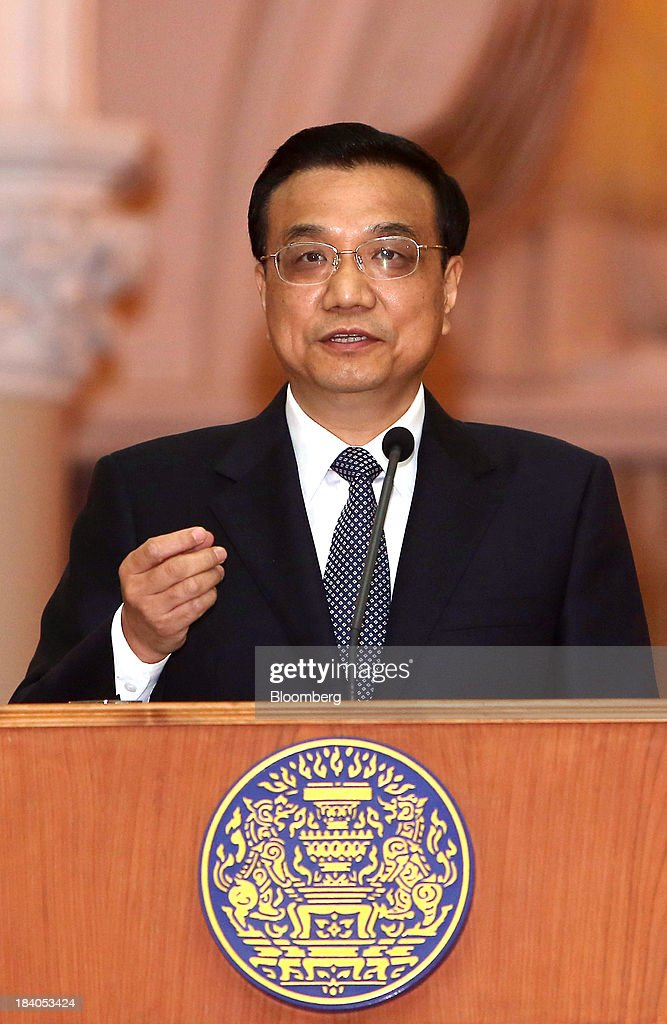 Li Keqiang, China's premier, gestures as he speaks during a news conference in Bangkok, Thailand, on Friday, Oct. 11, 2013. Li said his country wants to resolve disputes in the South China Sea through dialogue and urged Southeast Asian nations to spur more trade and investment. Photographer: Dario Pignatelli/Bloomberg via Getty Images