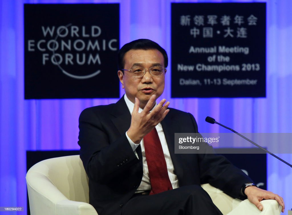 Li Keqiang, China's premier, gestures as he speaks during the opening plenary at the World Economic Forum Annual Meeting of The New Champions in Dalian, China, on Wednesday, Sept. 11, 2013. Li said the foundations of a growth rebound aren't solid while cautioning that stimulus won't help resolve deep-rooted issues in the world's second-largest economy. Photographer: Tomohiro Ohsumi/Bloomberg via Getty Images