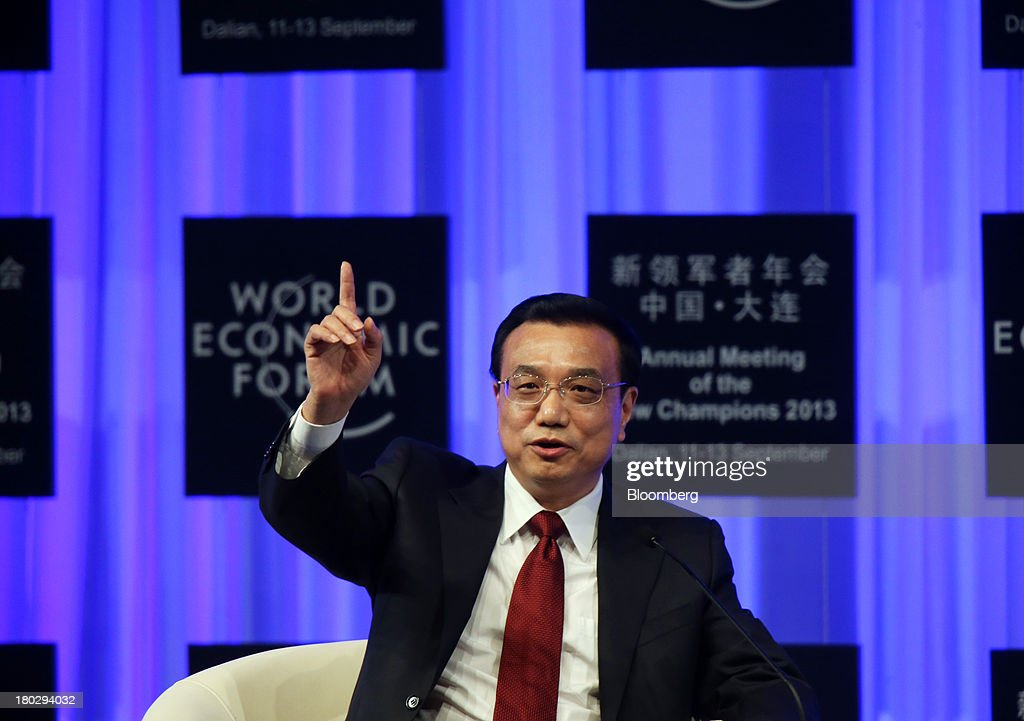 <a gi-track='captionPersonalityLinkClicked' href=/galleries/search?phrase=Li+Keqiang&family=editorial&specificpeople=2481781 ng-click='$event.stopPropagation()'>Li Keqiang</a>, China's premier, gestures as he speaks during the opening plenary at the World Economic Forum Annual Meeting of The New Champions in Dalian, China, on Wednesday, Sept. 11, 2013. Li said the foundations of a growth rebound aren't solid while cautioning that stimulus won't help resolve deep-rooted issues in the world's second-largest economy. Photographer: Tomohiro Ohsumi/Bloomberg via Getty Imagesg