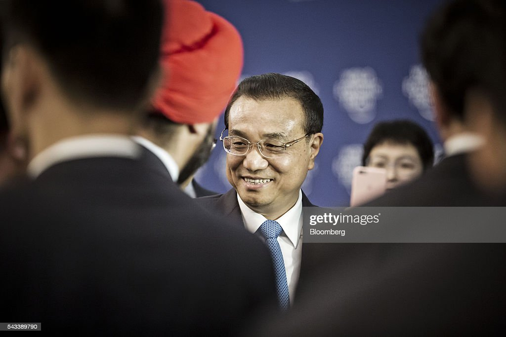 <a gi-track='captionPersonalityLinkClicked' href=/galleries/search?phrase=Li+Keqiang&family=editorial&specificpeople=2481781 ng-click='$event.stopPropagation()'>Li Keqiang</a>, China's premier, greets participants after a meeting with business leaders at the World Economic Forum (WEF) Annual Meeting of the New Champions in Tianjin, China, on Tuesday, June 28, 2016. China will make efforts to ensure stability of nation's financial and capital markets after Brexit jolted global markets said Li. Photographer: Qilai Shen/Bloomberg via Getty Images