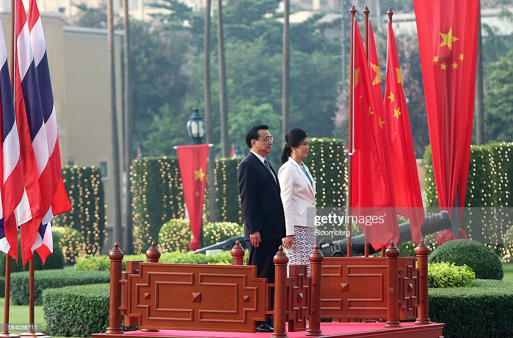 <a gi-track='captionPersonalityLinkClicked' href=/galleries/search?phrase=Li+Keqiang&family=editorial&specificpeople=2481781 ng-click='$event.stopPropagation()'>Li Keqiang</a>, China's premier, left, stands with <a gi-track='captionPersonalityLinkClicked' href=/galleries/search?phrase=Yingluck+Shinawatra&family=editorial&specificpeople=787330 ng-click='$event.stopPropagation()'>Yingluck Shinawatra</a>, Thailand's prime minister, during a welcoming ceremony in Bangkok, Thailand, on Friday, Oct. 11, 2013. Li said his country wants to resolve disputes in the South China Sea through dialogue and urged Southeast Asian nations to spur more trade and investment. Photographer: Dario Pignatelli/Bloomberg via Getty Images
