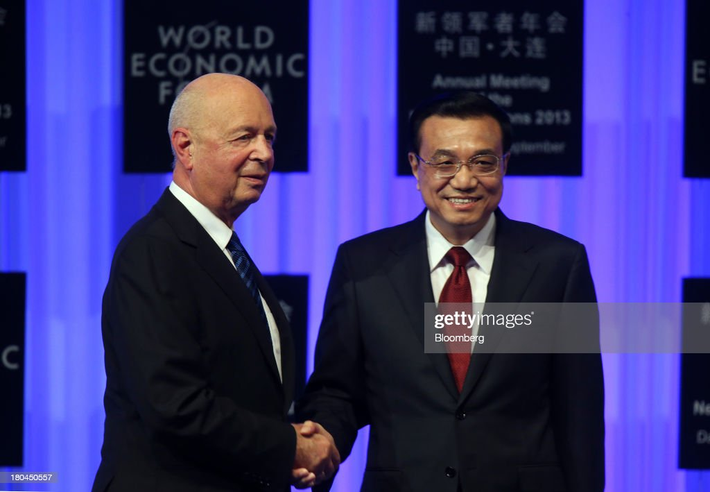 Li Keqiang, China's premier, right, shakes hands with Klaus Schwab, chairman of the World Economic Forum, during the opening plenary at the World Economic Forum Annual Meeting of The New Champions in Dalian, China, on Wednesday, Sept. 11, 2013. Li said the foundations of a growth rebound aren't solid while cautioning that stimulus won't help resolve deep-rooted issues in the world's second-largest economy. Photographer: Tomohiro Ohsumi/Bloomberg via Getty Images